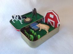 Imagination will go far with this little Farm Play Set. I have altered an Altoids Tin to Create a little farm complete with barn, garden, round bale feeder, water trough, And three farm animals. The barn has a magnet attached to the back for repositioning. Everything packs up nicely to keep in the tin for easy travel. It would make a great Quiet time toy for church, doctors office or in the car. Any child would love the hours of Play time this set offers. Please be cautious, this toy has…