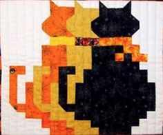 "Make Georgia Bonesteel's ""Shadow Cats"" using AccuQuilt GO! Half Square Triangle…"