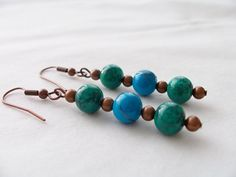 Deep green and turquoise glass earrings with bronze accents  by SparkleandComfort, $8.50