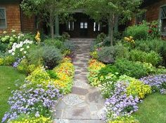 Low growing flowers & ground covers soften the edges of the path. - Heidi's Lifestyle Gardens