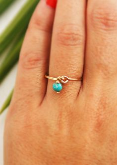 14k gold filled or sterling silver - please choose    Wire wrapped Turquoise hangs on a hammered hand crafted band. This ring can be also a stacking