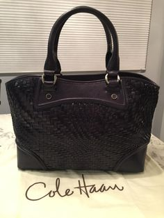 Cole Haan Genevieve Like New! Woven Leather Tote Handbag Navy Blue Satchel. Save 44% on the Cole Haan Genevieve Like New! Woven Leather Tote Handbag Navy Blue Satchel! This satchel is a top 10 member favorite on Tradesy. See how much you can save GORGEOUS!!! EXCELLENT CONDITION!!! BEAUTIFUL WOVEN LEATHER WEAVE NAVY BLUE BAG!!! VERY RARE!!! SALE!!! WOW!!!