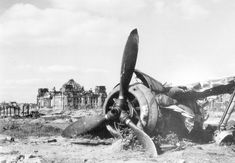 The wreckage of a crashed Focke-Wulf fighter in the bomb and artillery blasted Berlin wasteland near the abandoned Reichstag parliament building, seen in the background Neue Wache, Focke Wulf Fw 190, Kaiser Wilhelm, Luftwaffe, Second World, Berlin Germany, World War Two, Historical Photos, Wwii