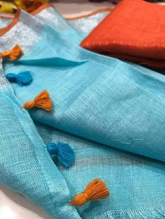 Pure linen saree with pom-pom detailing at pallu.This saree is handwoven by local weavers of Bhagalpur (Bihar) and zari work on border. It comes with an attached blouse piece. Indian Designer Suits, Designer Wear, Elegant Fashion Wear, Blue Saree, Elegant Saree, Work Sarees, Fancy Sarees, Saree Blouse Designs, Sari Blouse