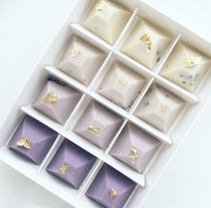 Purple Palette Pyramid Chocolates by Nectar and Stone. Our handmade chocolates include using Belgium couverture white chocolate with cookies and cream. The chocolate is tinted in a distinct colour palette which is signature to Nectar and Stone.