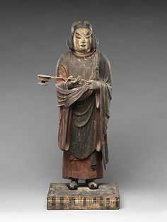 Prince Shotoku at Age Sixteen Period: Nanbokuchô period (1336–92) Date: 14th century Culture: Japan Medium: Painted wood with inlaid crystal eyes Dimensions: H. 30 1/4 in. (76.8 cm); W. 12 3/4 in. (32.4 cm); D. 11 1/8 in. (28.3 cm); H. (with base) 32 3/4 in. (83.2 cm) Classification: Sculpture
