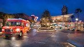 Food trucks parked beneath the vibrant evening lights of Disney Springs at Walt Disney World Resort