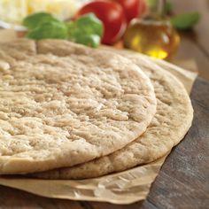 gluten-free pizza crusts on wood