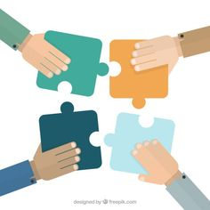 Hands putting puzzle pieces together