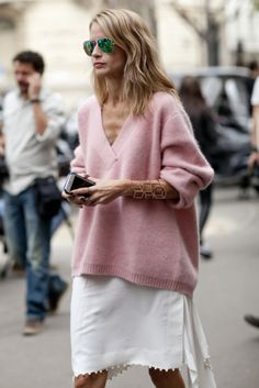 Très Chic! The Best Street Snaps at Paris Fashion Week: Feeling a little equestrian inspired.  : Every girl needs a great slouchy sweater like this in her closet for Fall.  : Elena Perminova is a print all-star.  : Floral dresses were made for wearing with bomber jackets, didn't you know? : Menswear with a bold accessory twist.  : Coordinating cat-eye shades.  : Giovanna Battaglia's look kind of makes us want to jump for joy too.  : Proof that simple can be simply stunning.