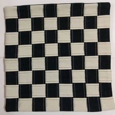 Another Chess Board in the making...  Eco-friendly Chess Board Cushion Cover  This cushion cover is made from eco-friendly handloom denim, and is completely hand-stitched on a foot pedal operated vintage sewing machine, by a seasoned tailor.  The chess-board design, made by interlacing strips of black and white denim fabric, is an ever-green design, and has a mesmerizing effect.  Both the fabrics are true 3x1 twill weave, made from 100% cotton singles yarn, black one dyed with the eco-fr
