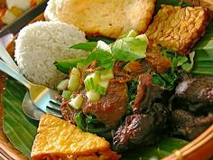 Pecel Madiun : rice, veggie, spicy peanut sauce, fried tempeh, fried tofu, fried beef!