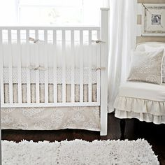 "Love this calm warm neutral set. Dainty and soft for my baby girl, but could easily be matched with some blues or greens if we have a little man in our future, too! ""Pebble Moon Crib Bedding Set"""