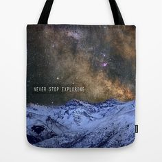 Never stop exploring mountains, space..... Tote Bag by Guido Montañés - $22.00