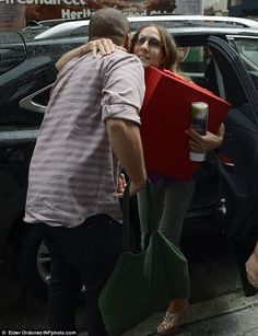 Warm welcome: The Sex and the City actress hugs a male friend