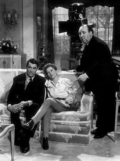 """""""Suspicion,"""" Cary Grant & Joan Fontaine with director Alfred Hitchcock. 1941 RKO"""