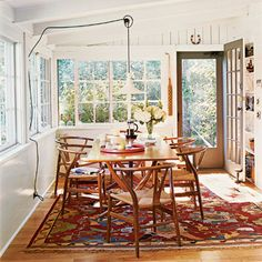 Danish Teak Dining Table and Wishbone chairs.  Love the patterned rug