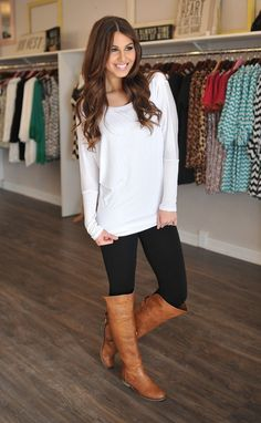 Cute, simple, and comfortable. Could also be dressed up with jewelry. Nice sweater and love her boots.