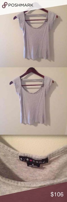 EYE CANDY Gray Short Sleeve Shirt. MED EYE CANDY Gray Short Sleeve Shirt.  Size Med  Has Shoulder pads which gives the shirt a cool shape! Very flattering scoop neck. Cool Back detail! Eye Candy Tops Tees - Short Sleeve