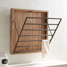 Laundry Baskets & Hampers Never enough space on laundry day? Let your walls help fix that. Our wooden drying rack mounts on the wall and its built-in metal rack pulls out to provide six bars of hanging space for your air-dry only items. Laundry Drying Rack Wall, Laundry Hanging Rack, Wooden Drying Rack, Hanging Drying Rack, Clothes Drying Racks, Wall Mounted Drying Rack, Laundry Baskets, Laundry Room Remodel, Laundry In Bathroom