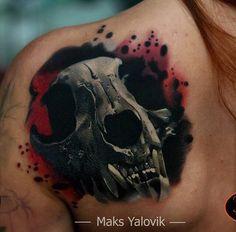 Interesting colored shoulder tattoo of big cat skull