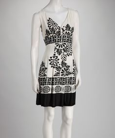 Take a look at this Ice Silk White Surplice Dress on zulily today!