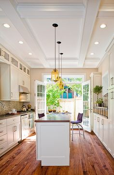 Love the double French doors - really opens the whole room. The ceiling is pretty cool. And the white cabinets and wood floor look really good together