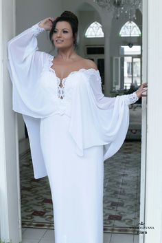 Plus size wedding gown with unique sleeves lace cleavage and sexy look. Klara. Studio Levana