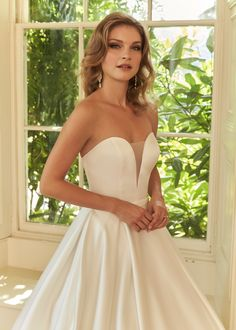 Stunning designs from the heart of the Devon Countryside. Satin Skirt, Signature Collection, Plunging Neckline, Ball Gowns, Glamour, Boutique, Bridal, Elegant, Wedding Dresses