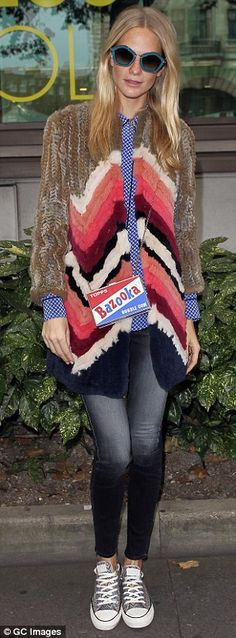 Poppy Delevingne teamed her furry coat with skinny, faded jeans and a Bazooka gum-inspired purse for the OSMAN and Anya Hindmarch presentations at #LFW http://dailym.ai/1wzWCxN
