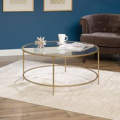 15 Modern Homes with Perfect Exteriors and Interiors Sauder International Lux Round Coffee Table in Satin Gold The Best of home decoration in Brass Coffee Table, Glass Top Coffee Table, Cool Coffee Tables, Round Coffee Table, Modern Coffee Tables, Glass Tables, Living Room Furniture, Living Room Decor, Living Spaces