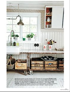 kitchen sink with exposed pipes. look what it's set into! think of the enameled pots and pans in a space like this...