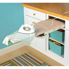 "<a href=""http://www.bhg.com/rooms/laundry-room/makeovers/easy-laundry-room-updates/?page=13"" target=""_blank""><b>BHG</b></a>…<b>BHG has yet another brilliant Idea…get the DIY on this pull-out ironing board that saves tons of space and you know how many times you have to take out an ironing board for all of those fabric projects. This is a real space save and organizer! Check it out!</b>"