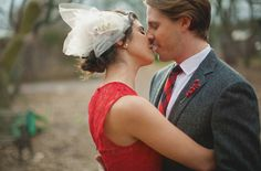 Beautiful red dress with tulle fascinator.
