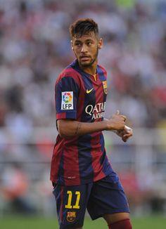 Neymar of FC Barcelona looks on during the La Liga match between Rayo Vallecano de Madrid and FC Barcelona at Estadio Teresa Rivero on October 4, 2014 in Madrid, Spain.
