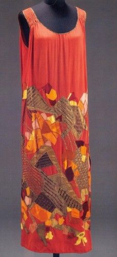 Evening dress of multi-coloured silk and velvet appliqué on red silk. Designed by Natalia Goncharova for Maison Myrbor, Paris, about 1923, V