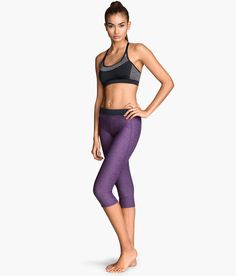Purple 3/4-length elastic yoga tights with fast-drying fabric & concealed mesh key pocket. | H&M Sport