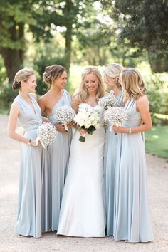 Color scheme love this blue! And the wrap style dresses for bridesmaids off etsy