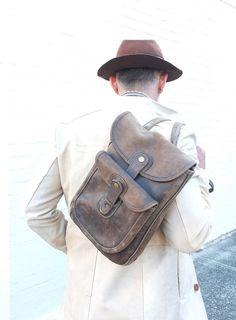 Contraband vintage 3-pocket leather bag.