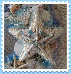 This appears to be part of a wreath - someone took a lot of time with the details. Note the tiny mermaid on top of the starfish. It's all so pretty!