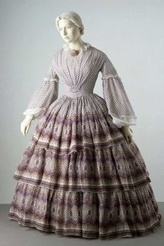 Crinoline daytime dresses were either one or two pieces; one piece with with bodice and and skirt seamed together at the waistline; or two, with matching but separate bodice and skirts