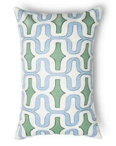 A striking geometric pattern lends color and fun to a textured accent pillow perfect for livening up the décor.