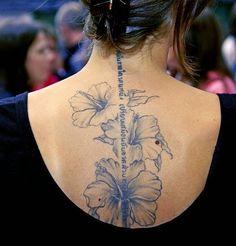 flower spine tattoo with script