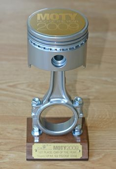 car trophies | One-of-a-kind custom trophies handcrafted from recycled VW auto piston ...
