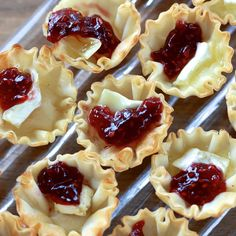 Raspberry Brie Bites...  You'll love making these because they're so simple. Your guests will love eating them because they're tasty little things, as all brie fruit combinations are! Make these for your next gathering and watch them disappear!