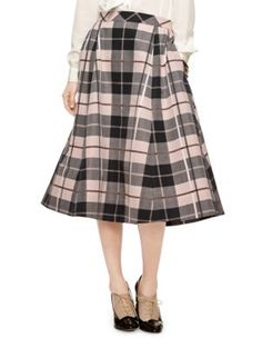 the combination of a menswear-inspired pattern (the large-format plaid) with a ladylike midi shape leads to a skirt that's surprisingly versatile--we love it with other pieces that walk the masculine/