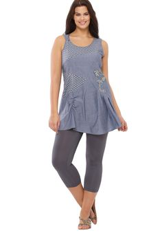"Look chic in our chambray plus size tunic.  this top beautifully fits at the bodice and A-lines away creating an elegant silhouette that is both flattering and comfortable features polka dot fabric at U-neckline that flatters the face in style embroidery and shirring at the bodice create interest and add an alluring touch sleeveless to keep you cool and confident hidden side zip for ultimate comfort and ease at about 36"" this tunic meets you at the lower thigh for ultimate coverage and…"