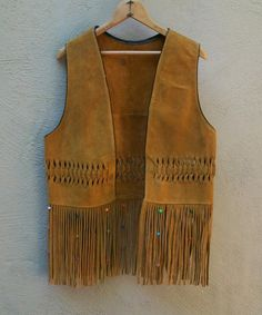 Vintage 1960's Fringed Leather Hippie Vest with Pony Beads S/M. $98.00, via Etsy.
