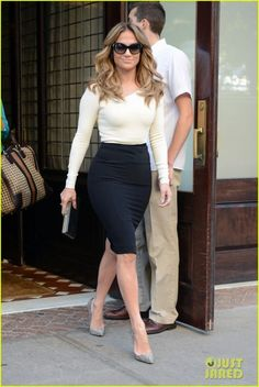 Tuck a long sleeve into black pencil skirt for work