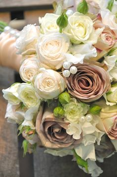 The wedding bouquet contained soft Amnesia roses combined with Bombastic spray roses, scented ivory sweet peas, ivory Majolika spray roses, Upper Secret roses, subtle hints of eucalyptus and wired pearls, nestled between the flowers. The bouquet was bound in a ruched nude satin ribbon, with large pearls lining the length. http://greenparlour.com/blog/tag/vintage-wedding-bouquet/